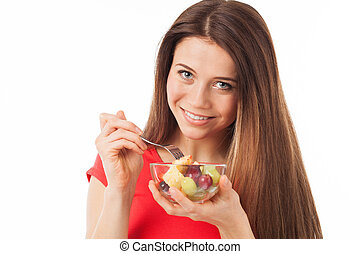 Pretty young woman eating fruits - Young woman eating fruits...