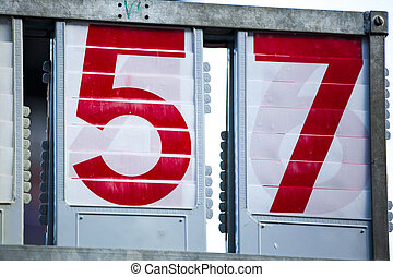 Two digit numbers fifty-seven in red