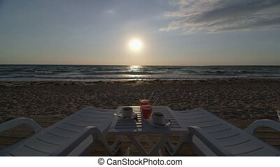 Dolly: Two sunbeds on summer beach - Two sunbeds, table with...