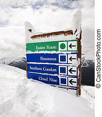 Snow covered sign - Snow covered sign with arrows to slopes...