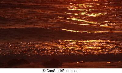 Golden sea waves at sunset