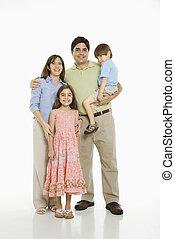 Hispanic family. - Hispanic family standing against white...