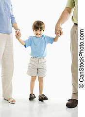 Boy with parents. - Boy holding hands with parents standing...