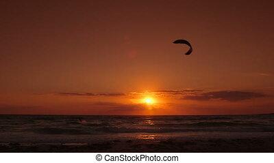 Kitesurfer silhouette at sunset