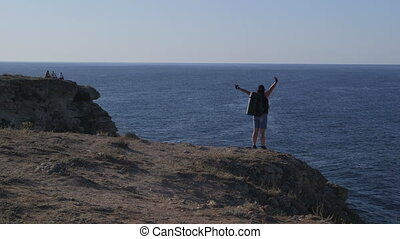 Hiker Overlooking Rocky Shoreline - Woman Hiker Overlooking...