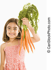 Girl holding carrots. - Smiling girl holding bunch of...