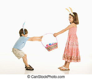 Children with Easter basket. - Boy and girl wearing bunny...