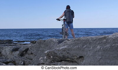 Woman With Bicycle on Rocky Beach, Tarhankut, Crimea