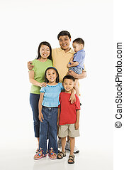 Happy Asian family - Asian parents with three children...