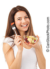 Cheerful woman eating fruits