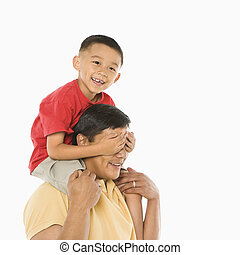 Son on father\'s shoulders. - Asian boy sitting on father\'s...
