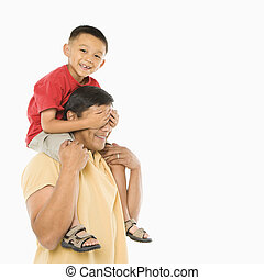 Son on dad\'s shoulders. - Asian boy sitting on father\'s...