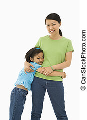 Mother and daughter - Asian mother and daughter standing...