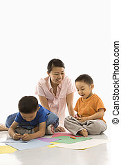 Boys coloring with mother. - Asian mother with boys...