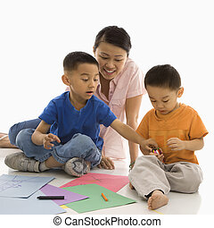 Boys coloring with mother - Asian mother with boys coloring...