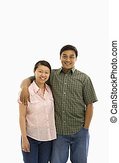 Mid adult Asian couple. - Asian man and woman standing with...