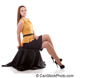 Beautiful girl sitting on a chair isolated on white background