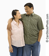 Smiling Asian couple.