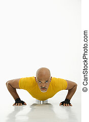Man doing pushups. - Mid adult multiethnic man wearing...