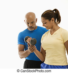 Woman and man exercising.
