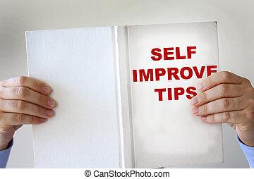Self improvement fake book - Hands holding a self...