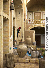 It is a garden in Persia with a parrot, flowing water,...