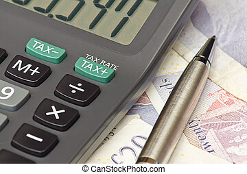 Tax return calculator - Calculator and pen symbolizing...