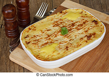 Fish pie on wooden table - Traditional Homemade Fish Pie in...