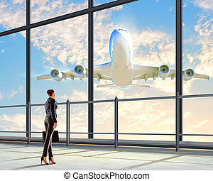 Businesswoman at airport - Image of businesswoman at airport...