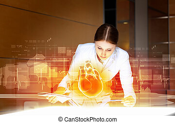 Woman cardiologist - Image of attractive woman cardiologist...
