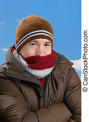 Cold Weather - Man bundles up in winter clothing