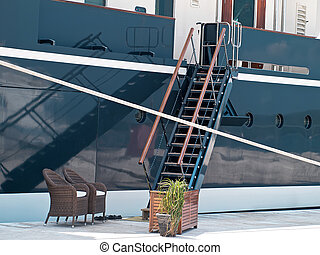 Gangway - modern yacht moored in the port, gangway and...