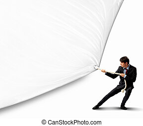 Businessman pulling blank banner - Image of young...