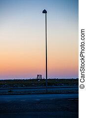 tall street lantern at dawn