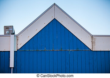 blue wooden gable - pointy gable of a blue and white wooden...