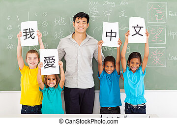 male Chinese teacher with group multiracial students -...