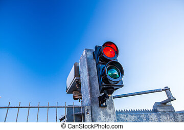 red traffic light - glowing red traffic light in front of a...