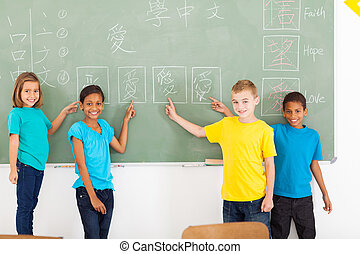 primary school students pointing their Chinese writing work...