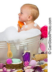 Cute little girl in a bubble bath - Cute little blond girl...