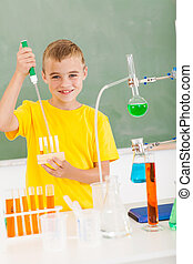 primary schoolboy in science class
