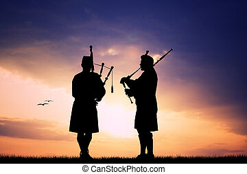 Pipers at sunset - Pipers silhouette at sunset