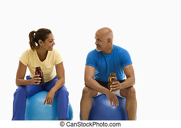 Two people on break. - Mid adult multiethnic man and woman...