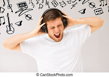 man with headphones listening loud music - music and...