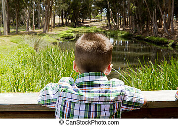 Young Boy - A young boy looks out into the distance