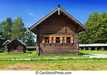 Open-air museum of  ancient wooden architecture. Russia. Vitoslavlitsy, Great  Novgorod. Church and well