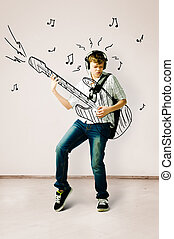 playing on drawn guitar - teenager is playing on drawn...
