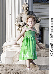 A girl in a museum - A girl is going down the stairs in...