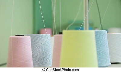 Colorful spools of thread background, close-up