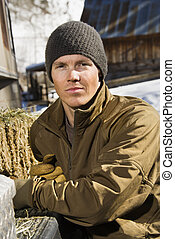 Man outdoors. - Young Caucasian man wearing hat outdoors in...