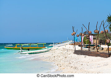 Small wooden long boats on blue sea - Small wooden tourist...